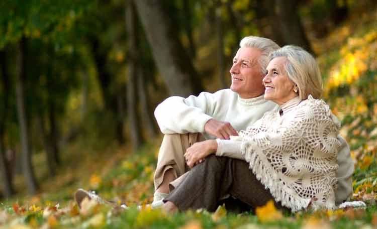 elderly couple enjoying sitting in the park